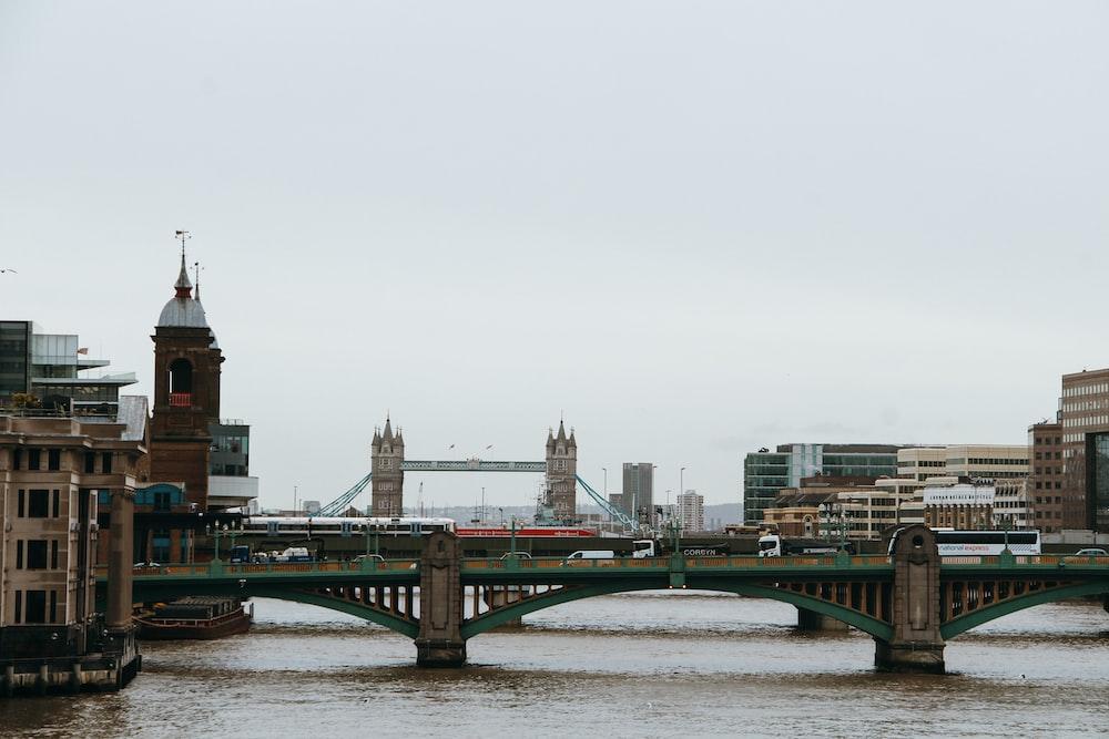green bridge over river during daytime