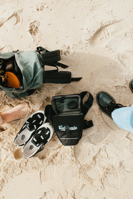 black and white nike backpack on white sand