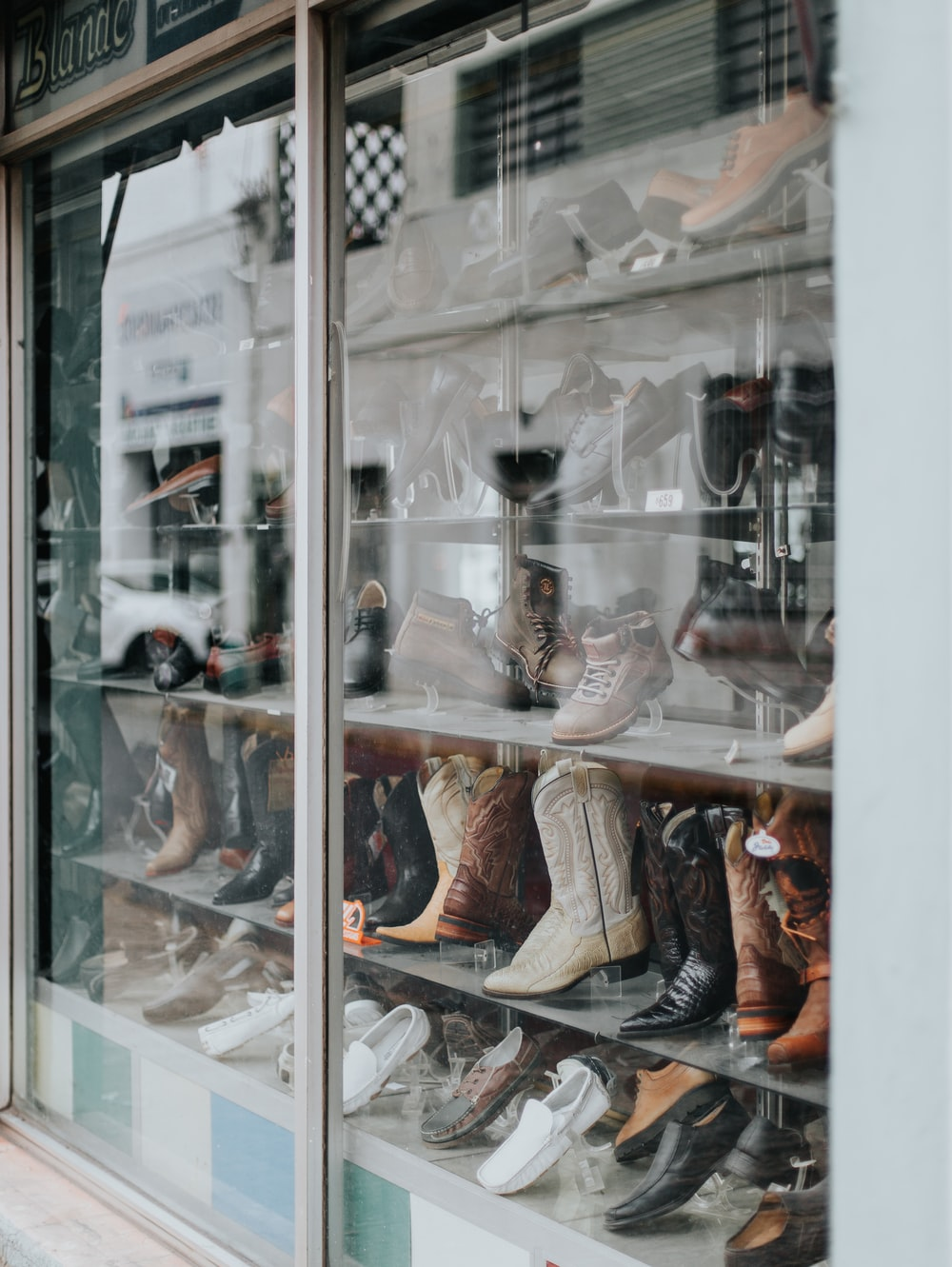 brown leather boots on display