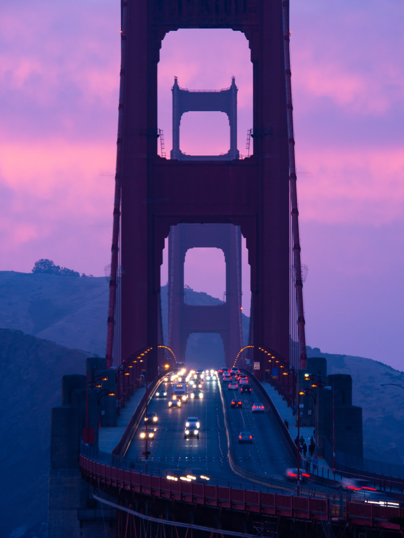 cars on bridge during night time