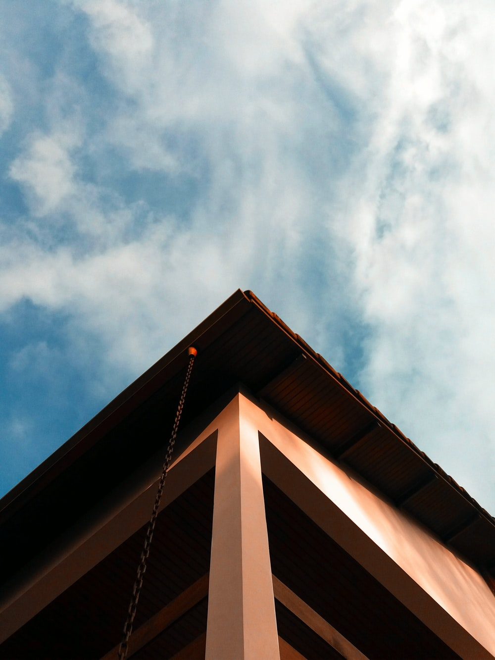 brown wooden roof under blue sky