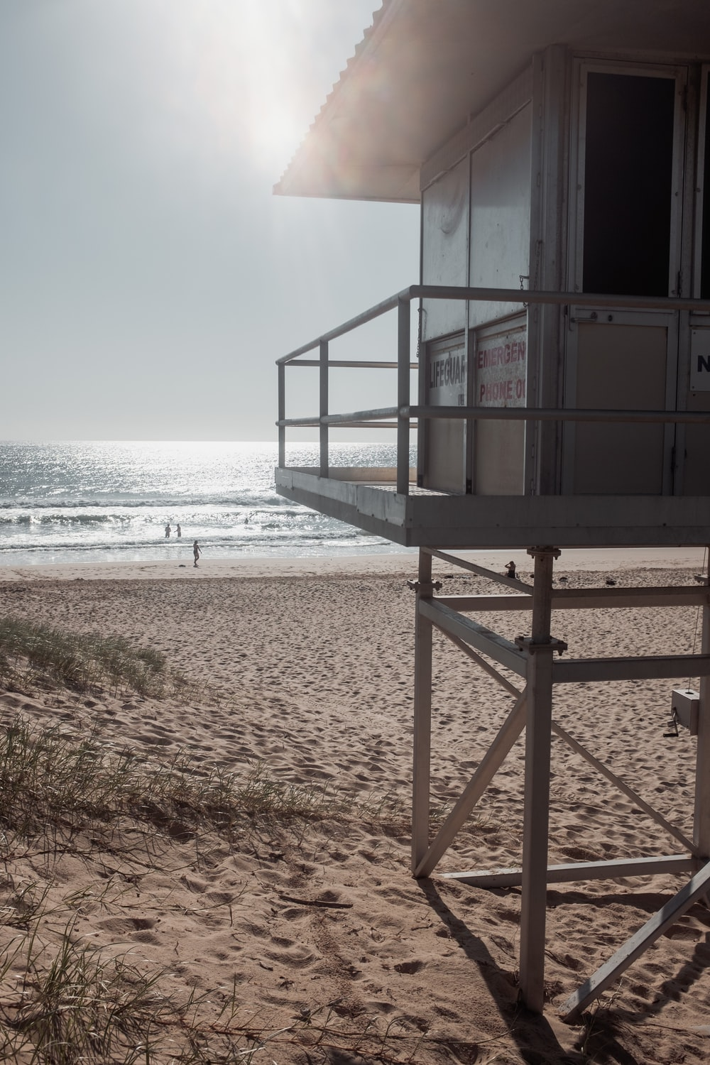 brown wooden lifeguard house on beach during daytime
