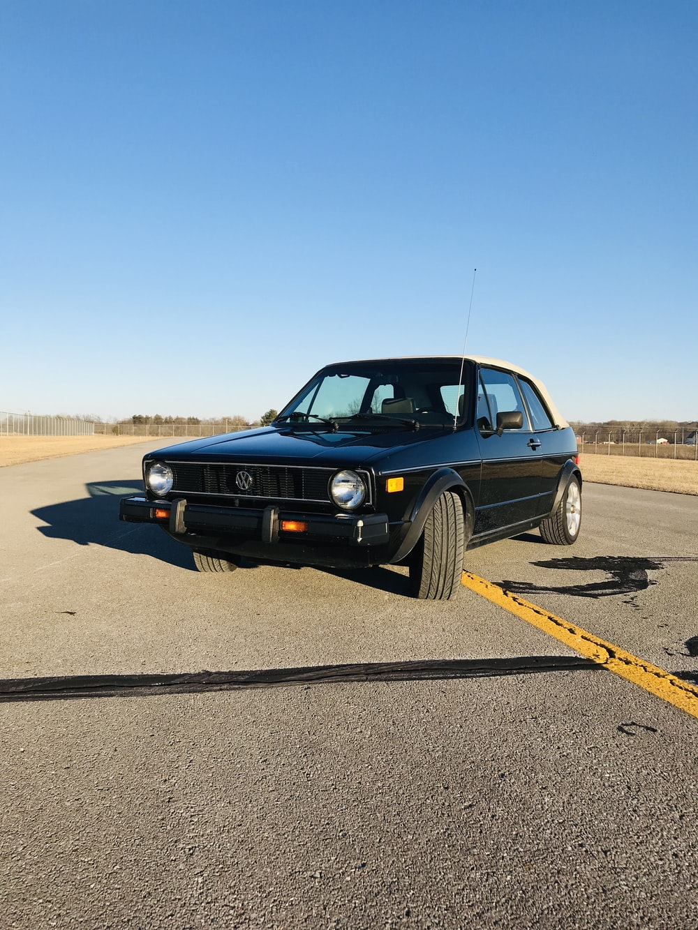 black chevrolet camaro on road during daytime