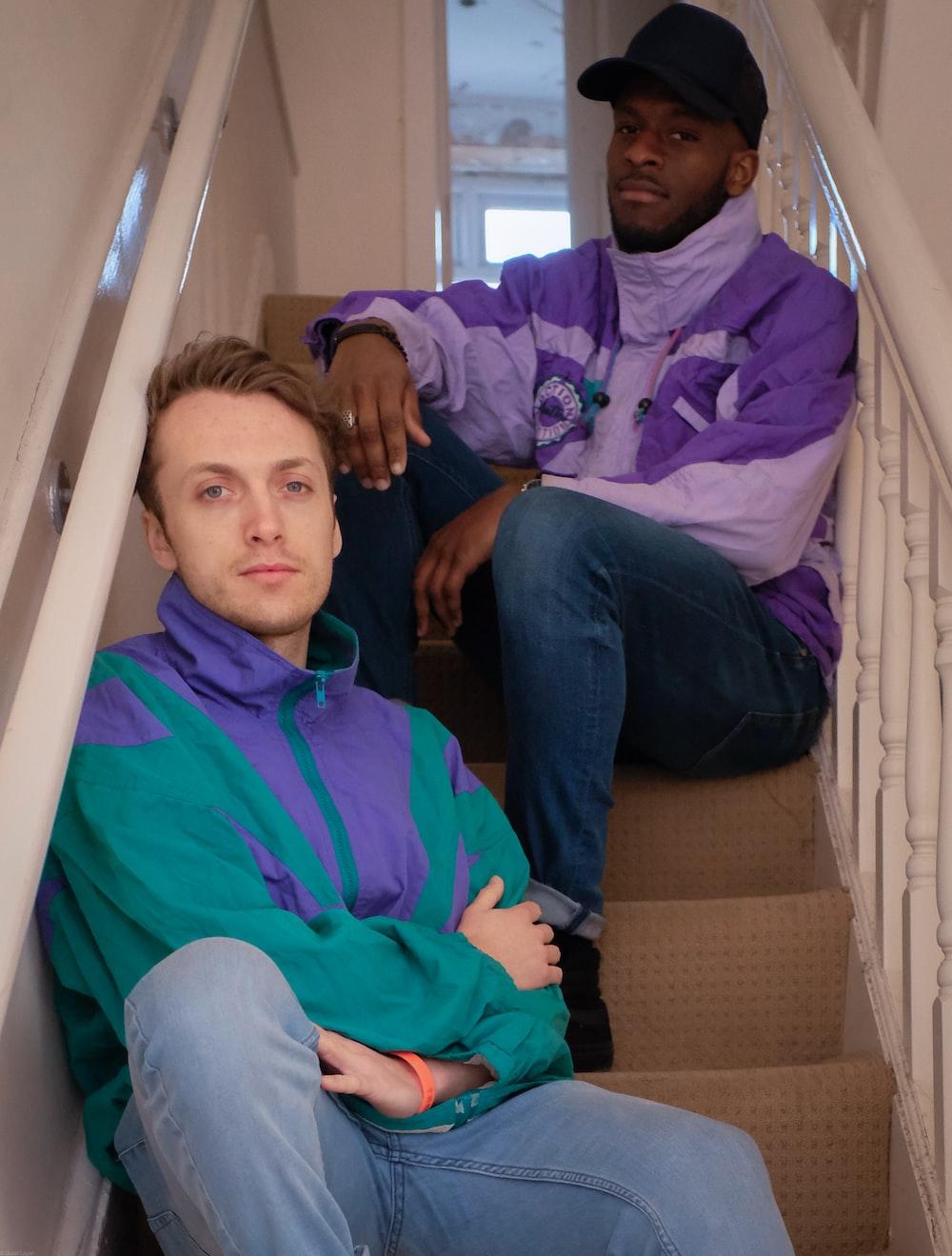 man in blue dress shirt sitting beside man in blue dress shirt