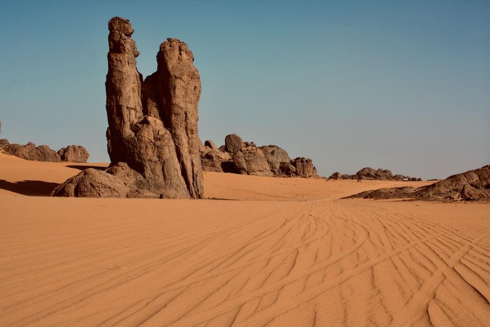 brown rock formation on desert during daytime