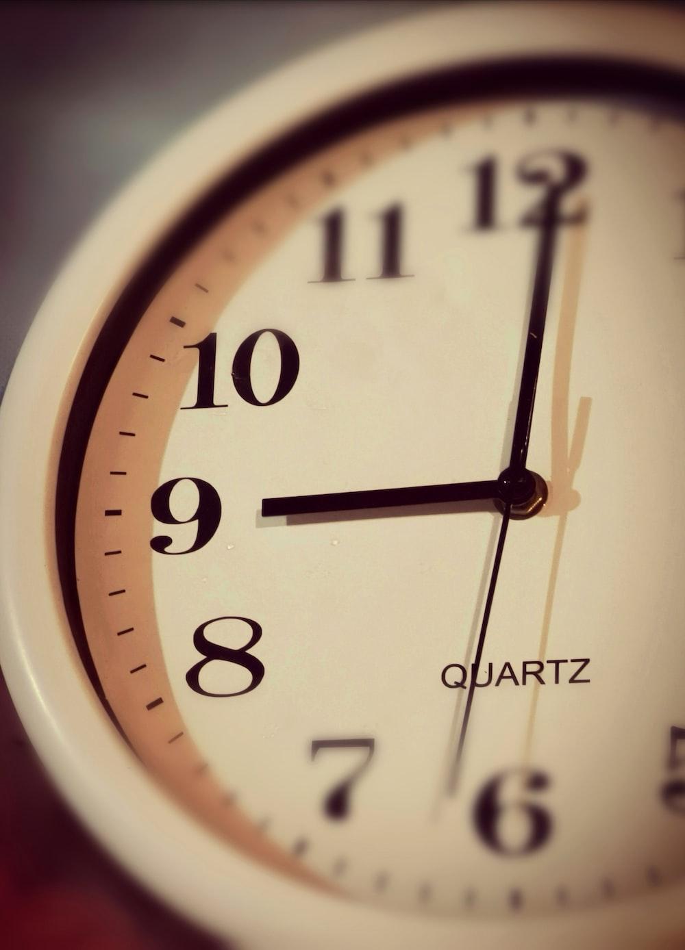 white and brown analog clock