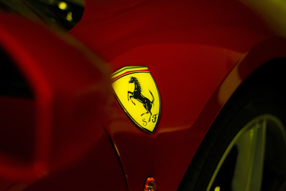 red and yellow car in close up photography