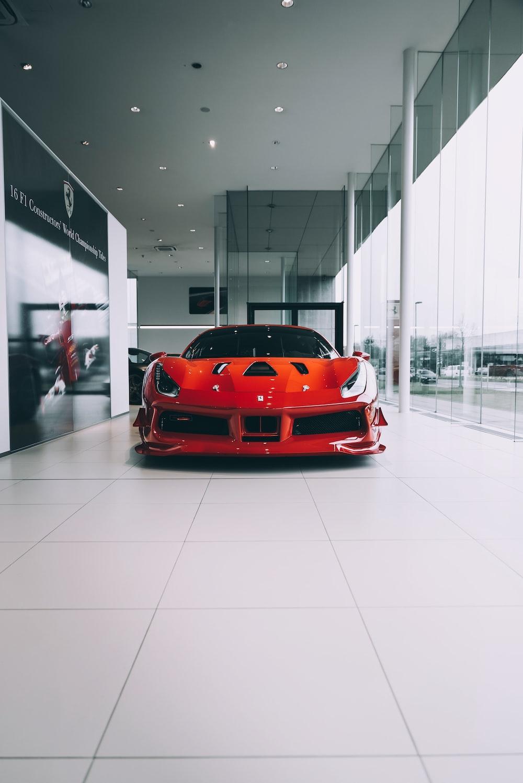 red ferrari car in a white room