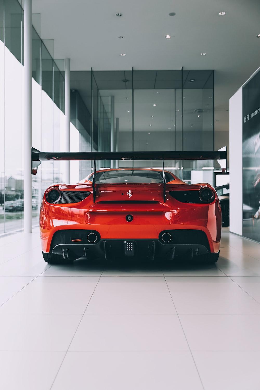 red ferrari 458 italia parked inside building