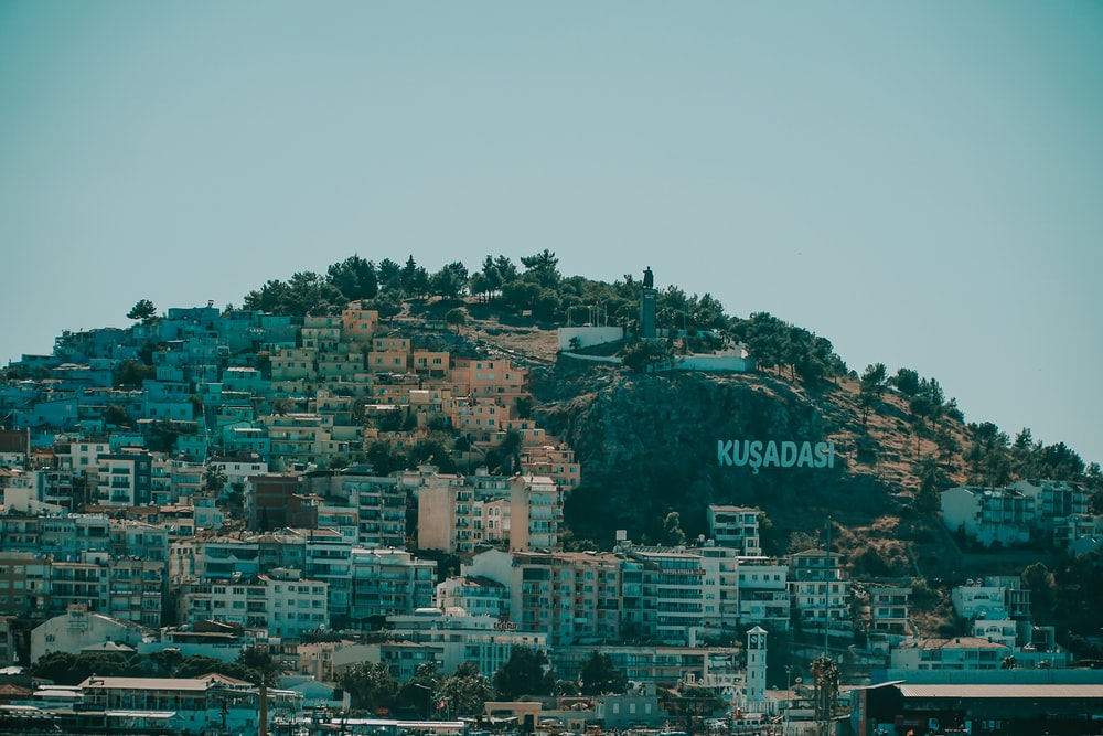 city buildings on top of mountain during daytime