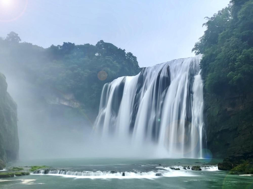 waterfalls under white sky during daytime
