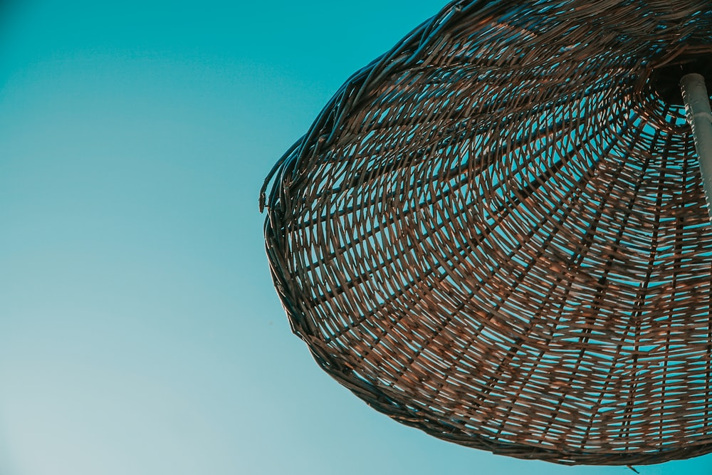 brown wicker basket under blue sky during daytime