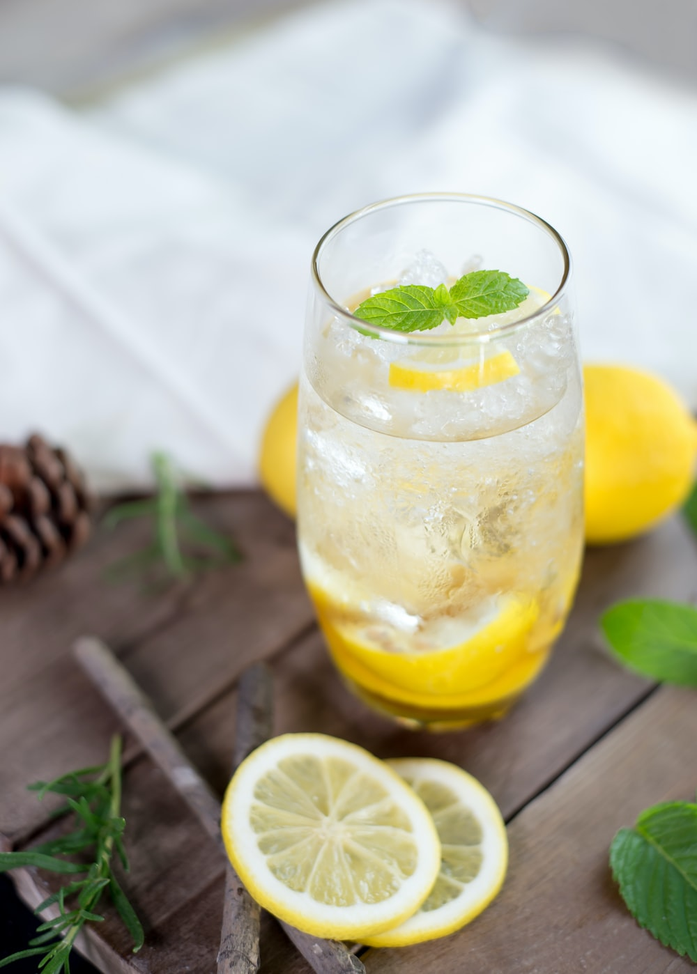 clear drinking glass with yellow liquid