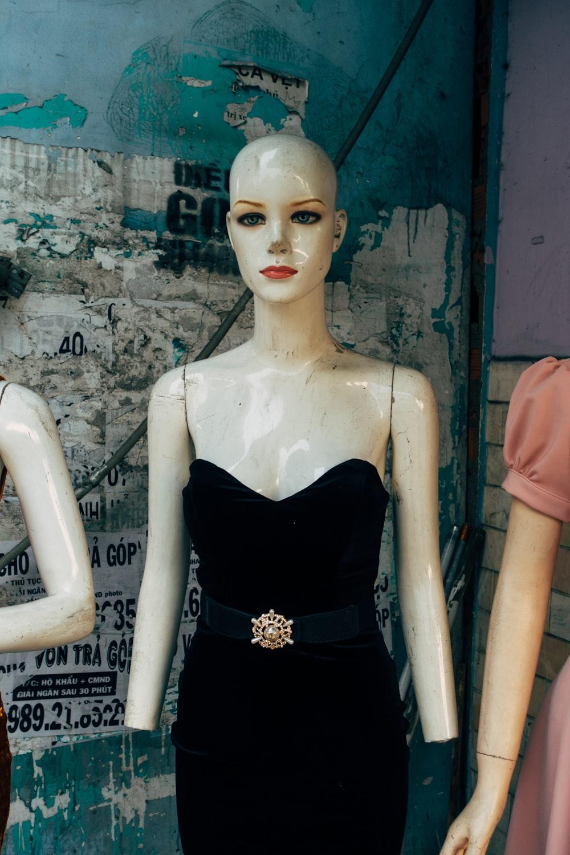 mannequin in black spaghetti strap dress