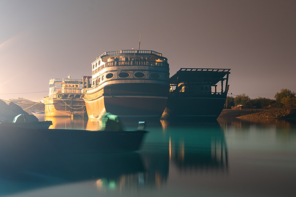 white and black ship on water during night time