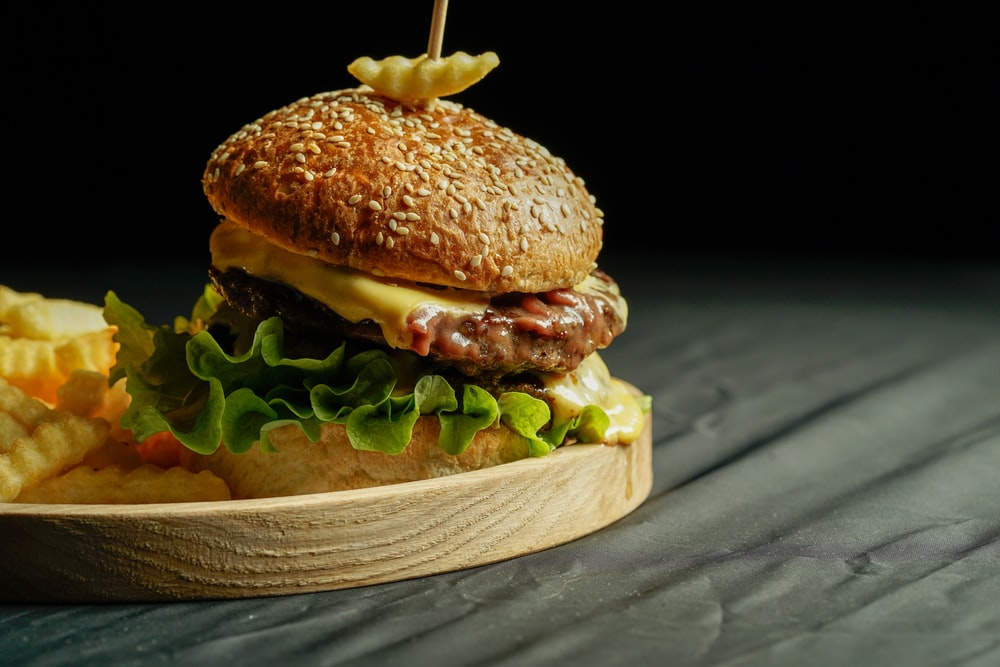 burger on brown wooden tray