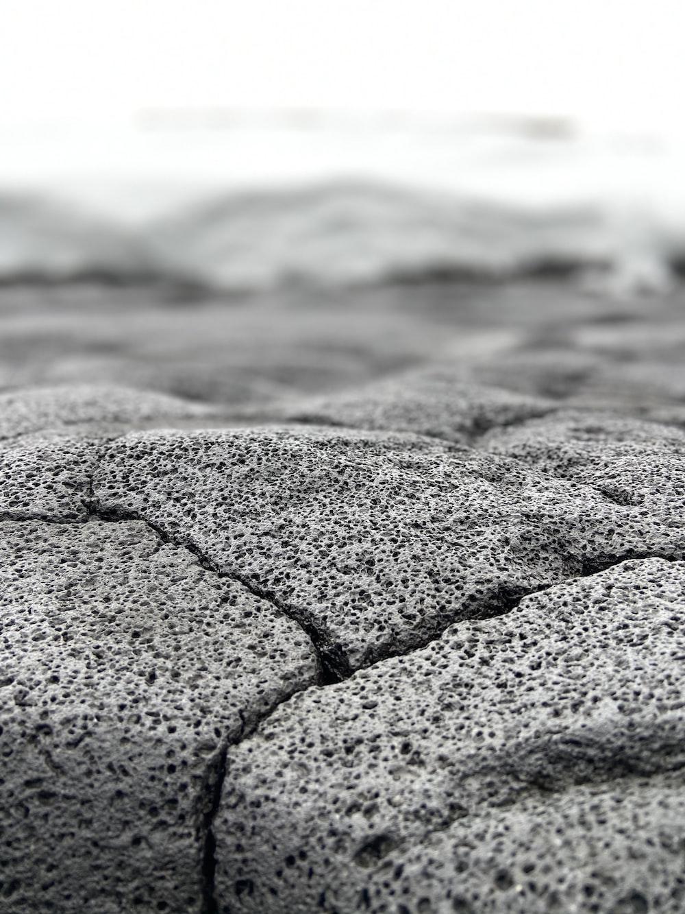 gray stone on seashore during daytime