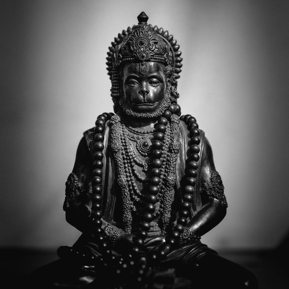 gold buddha figurine on black table
