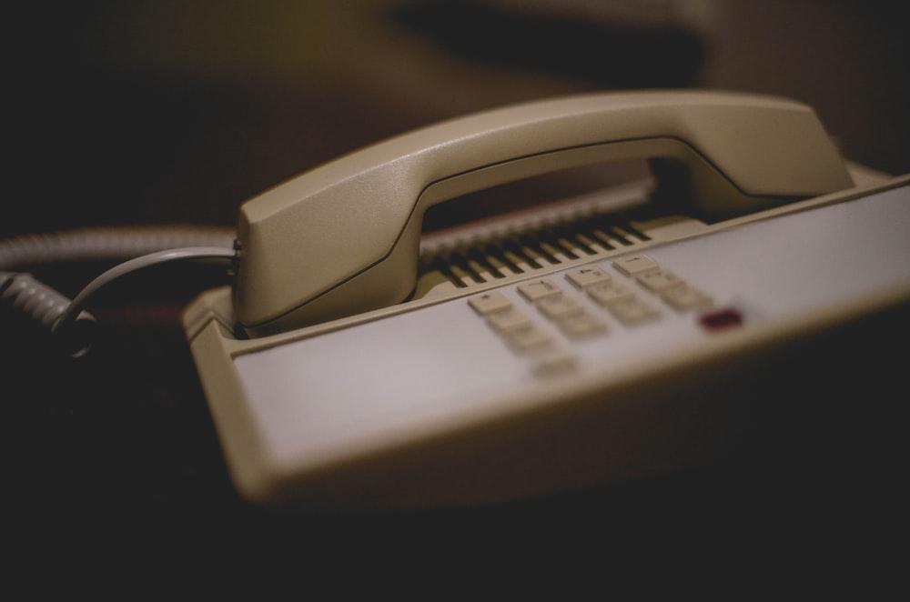 white and gray ip phone