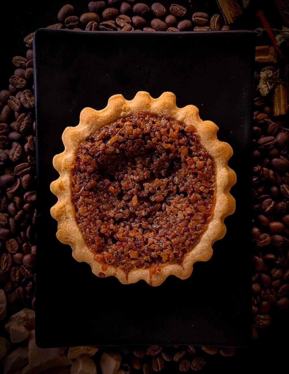 brown pie on black surface