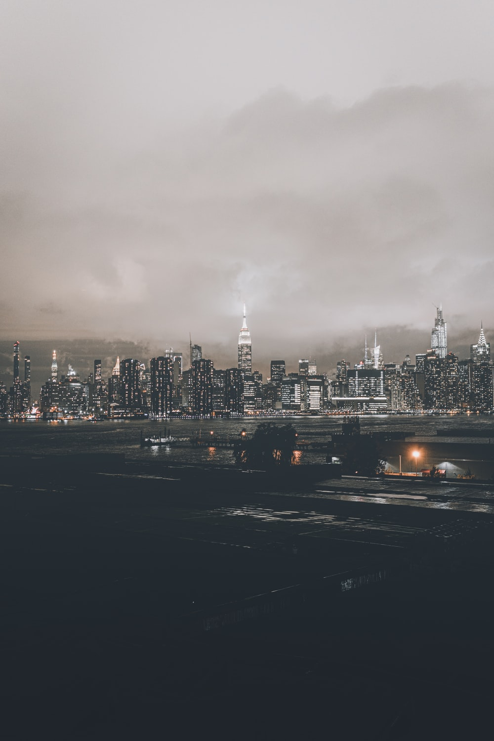 city skyline under gray cloudy sky during daytime