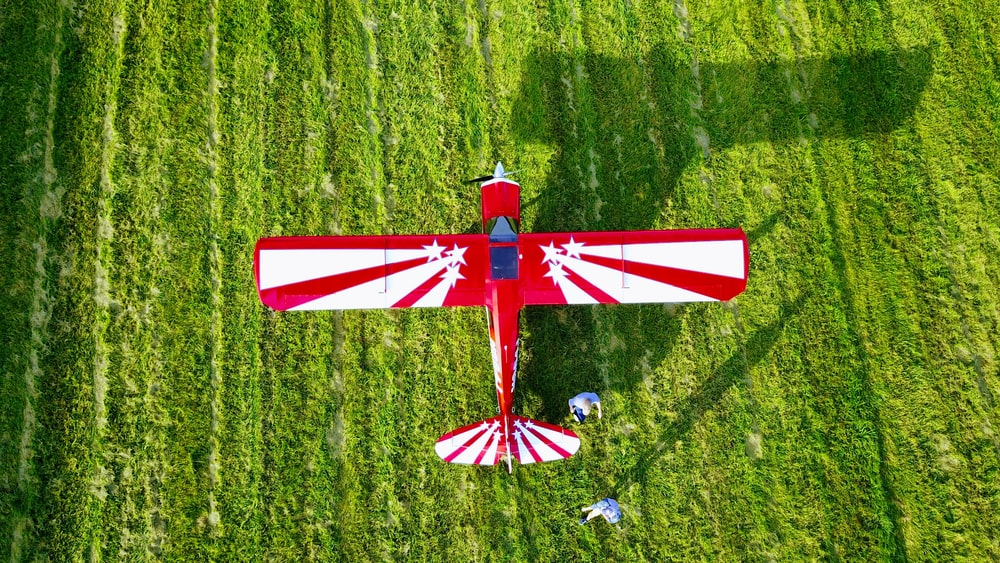 red and white windmill on green grass field during daytime