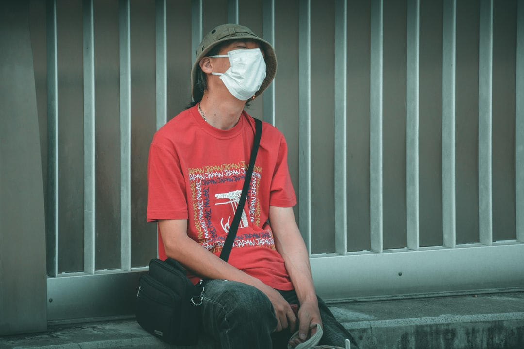 Street person wearing a sanitary mask