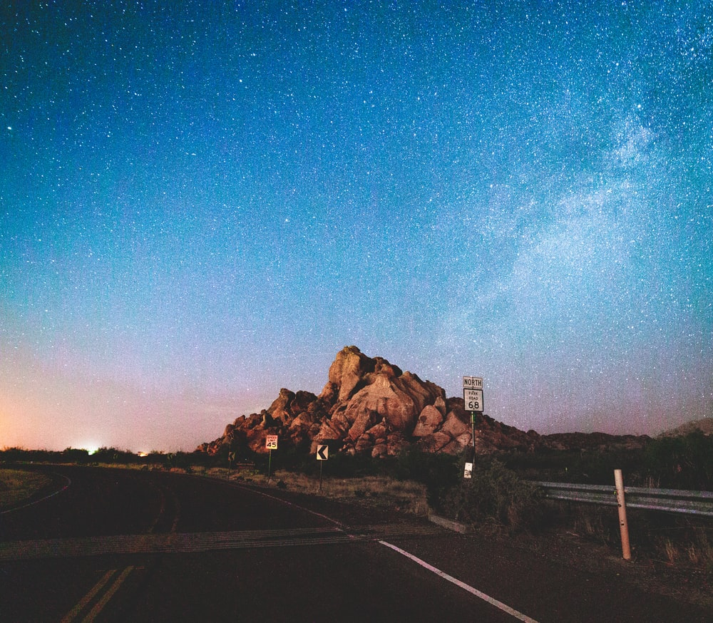 brown rock formation under blue sky during night time