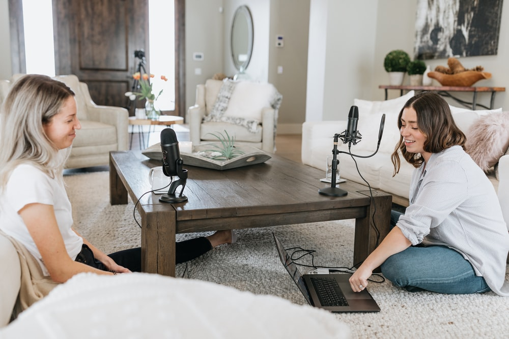2 women podcasting together