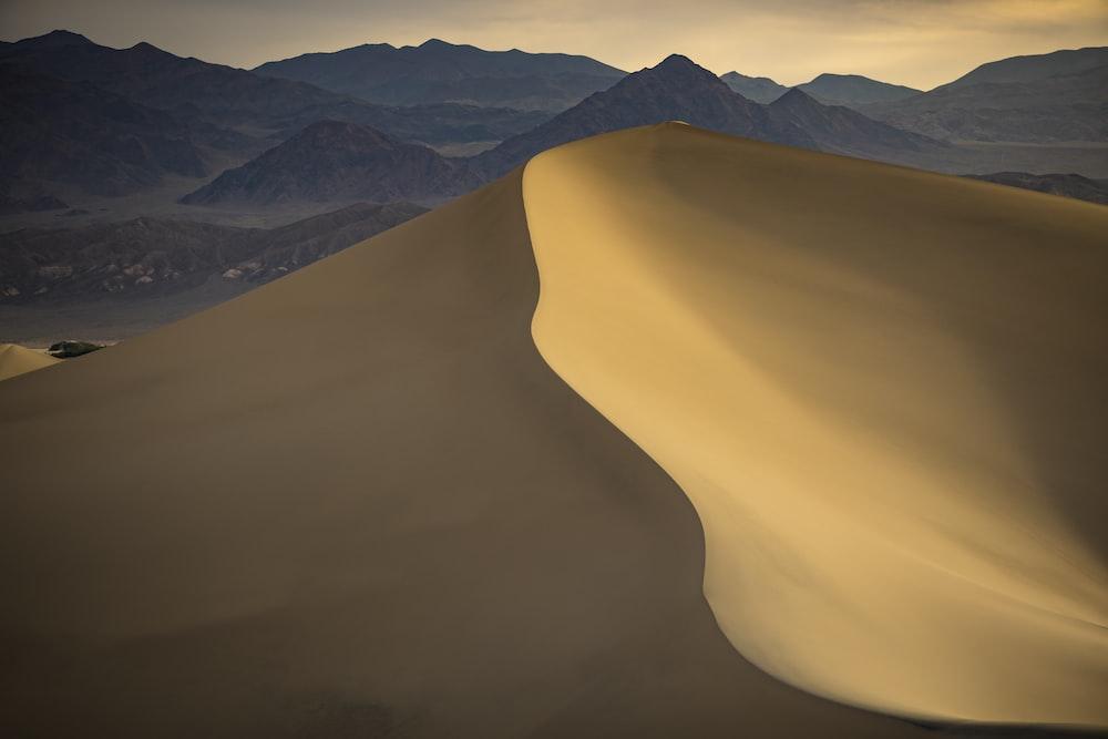 brown sand mountain during daytime
