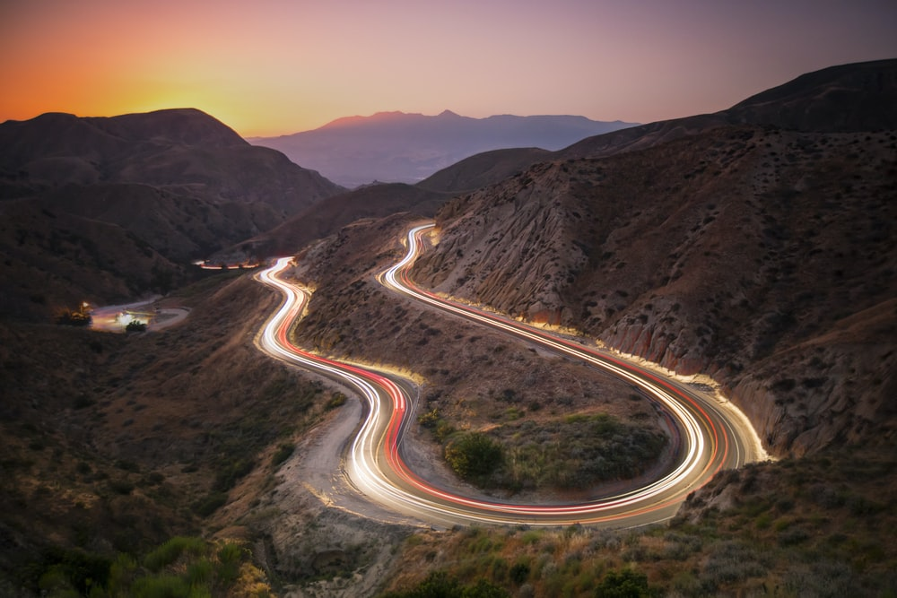time lapse photography of cars on road during daytime