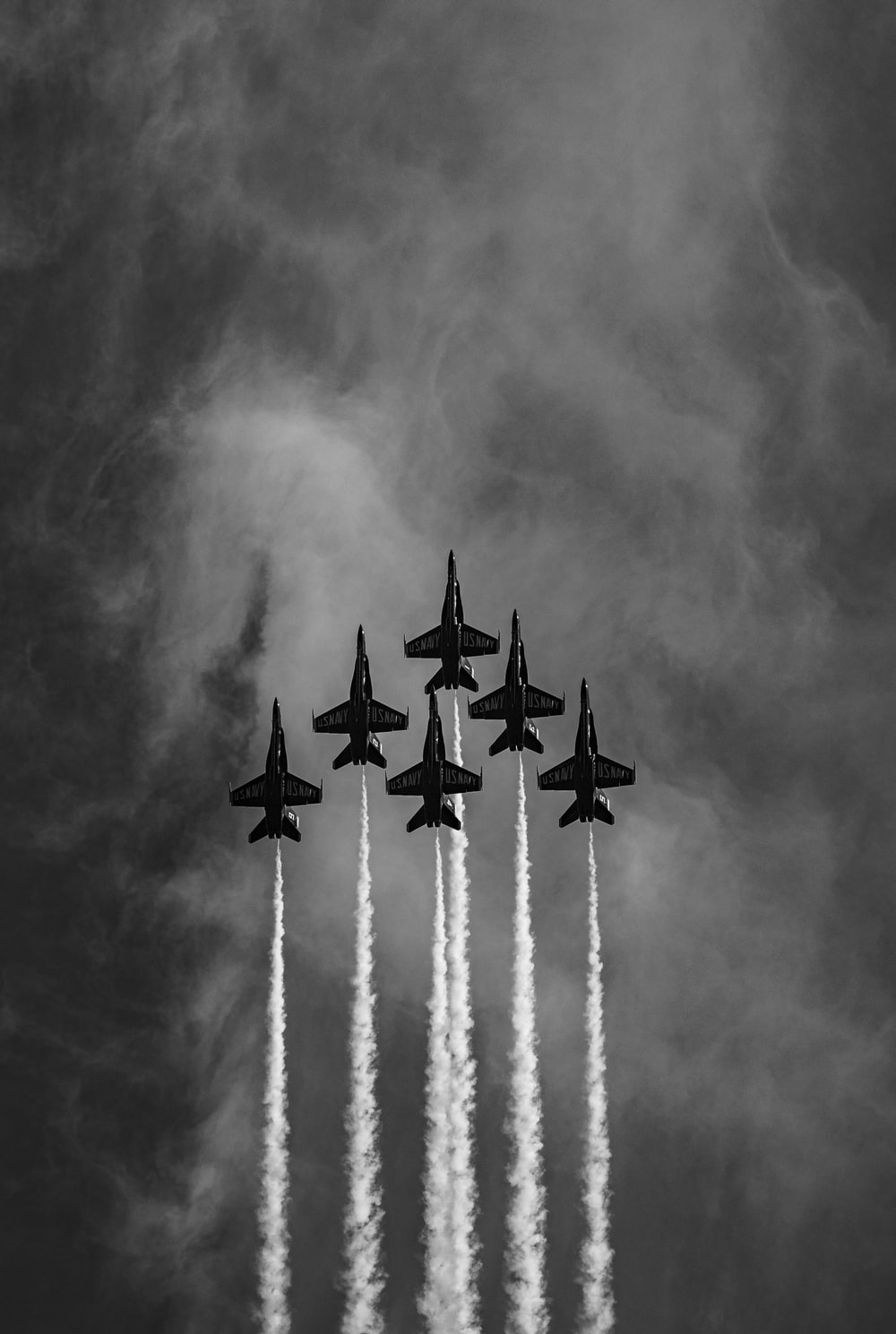 four fighter planes in grayscale photography