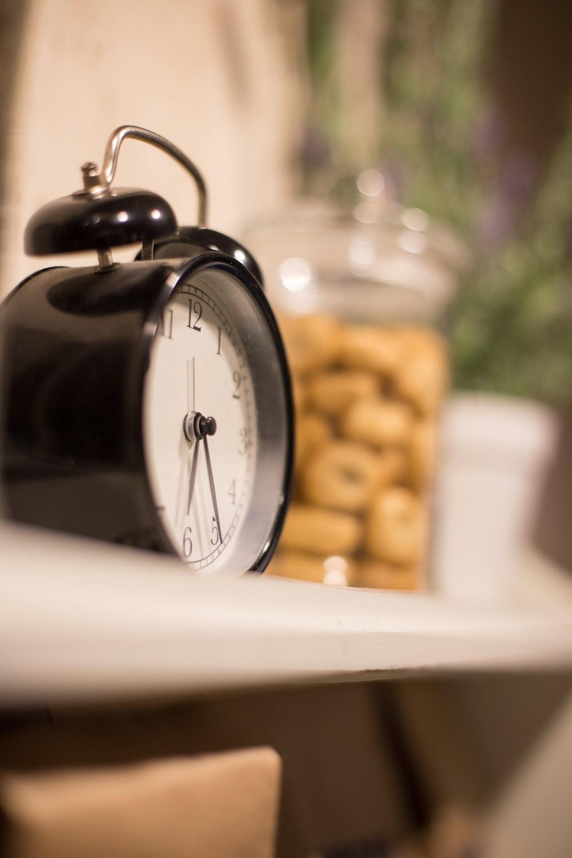 black and silver alarm clock