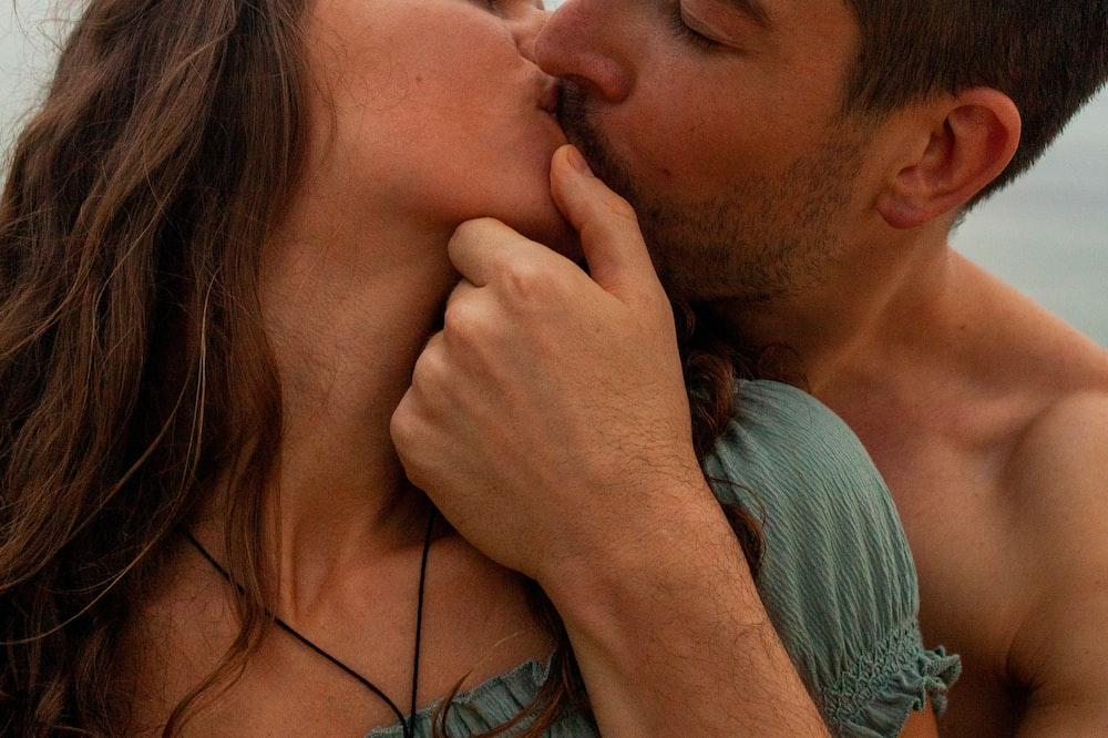 man kissing womans cheek