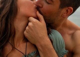 man kissing womans cheek