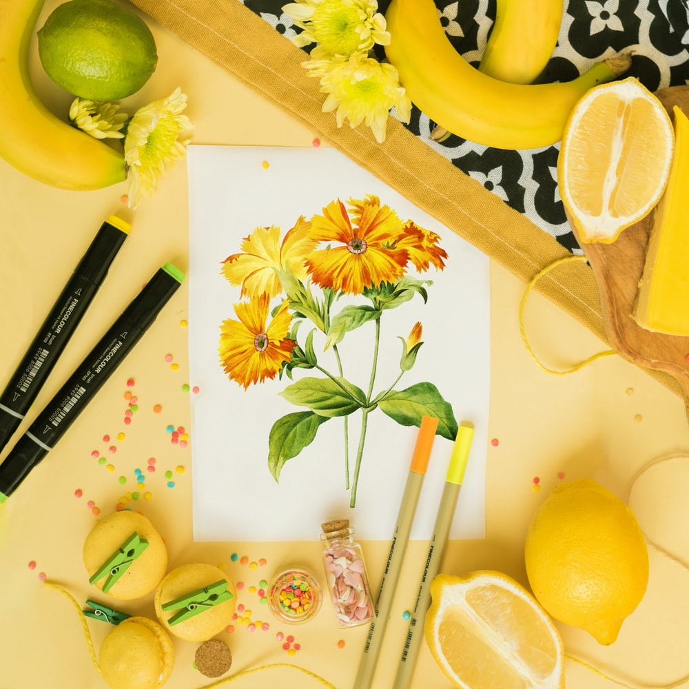 yellow and green fruits on white table