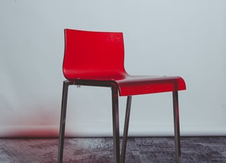 red and white chair on white floor