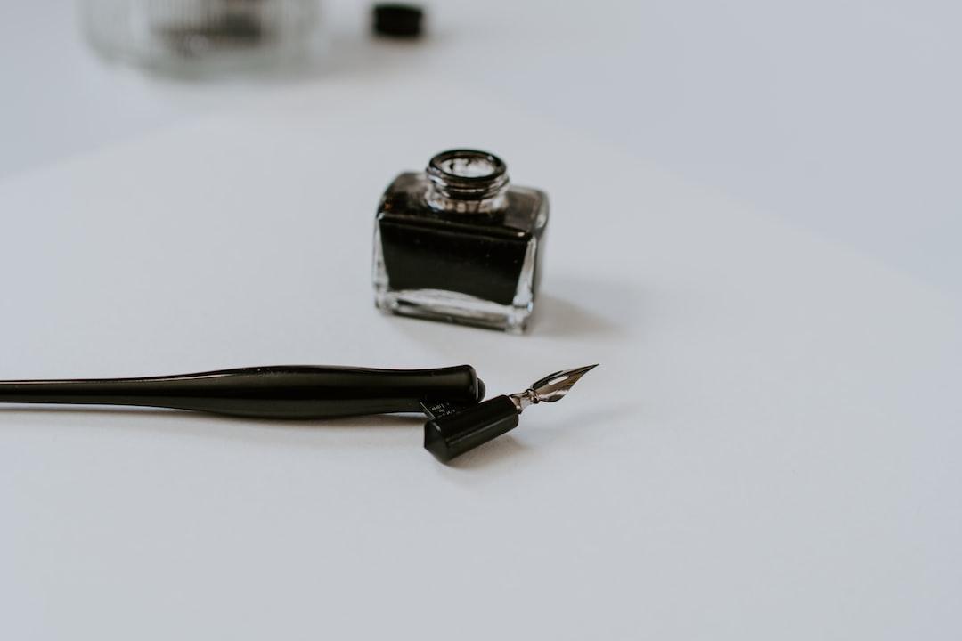 Straight pen oblique holder with a jar of black ink