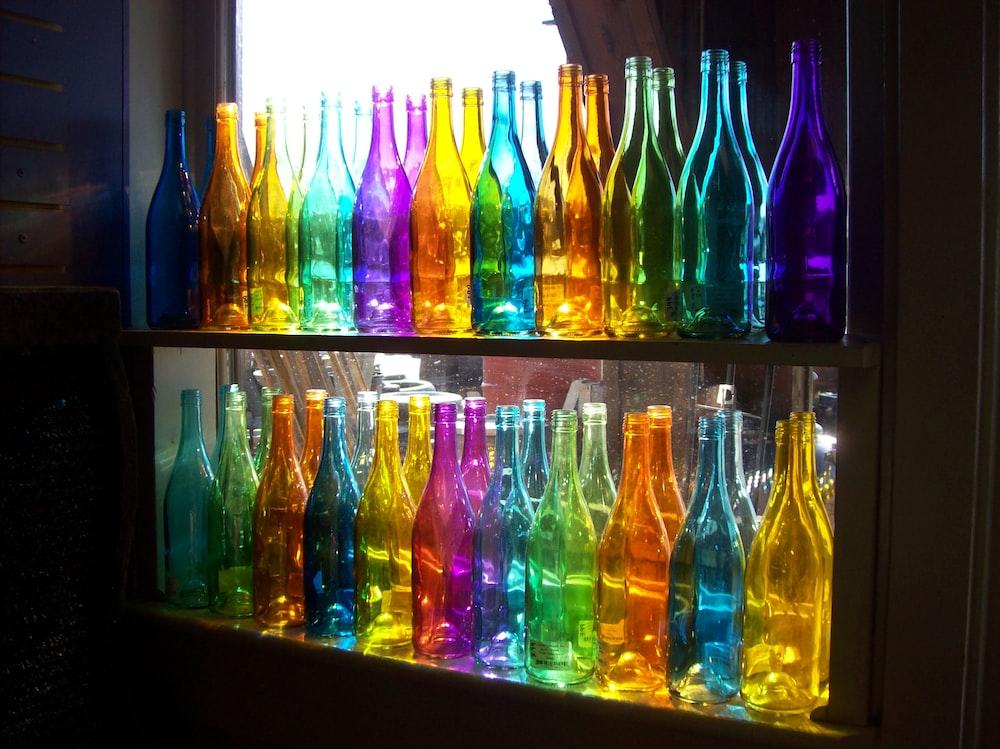 multi colored glass bottles on shelf