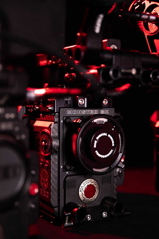 black nikon dslr camera with red lights