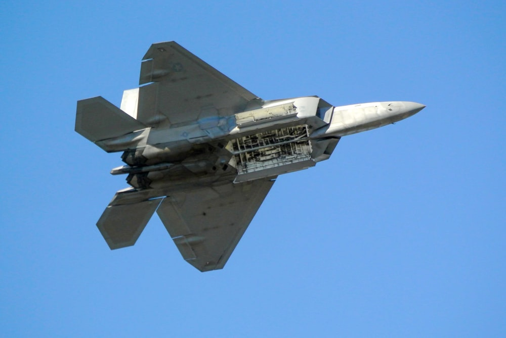 gray fighter jet in mid air during daytime
