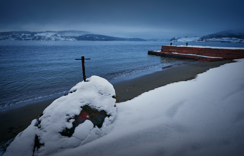 brown wooden dock on snow covered ground during daytime