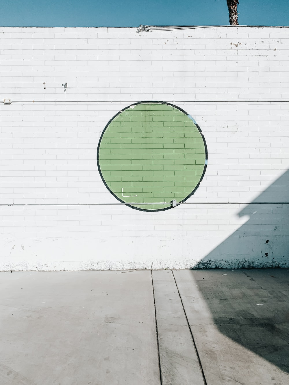 green round ball on white wall