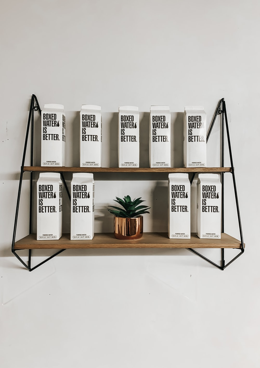 white and black labeled boxes on brown wooden rack