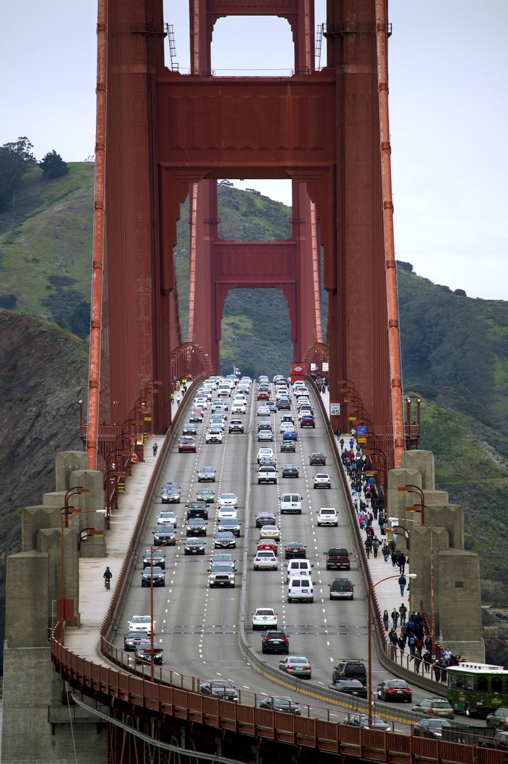 cars on bridge during daytime