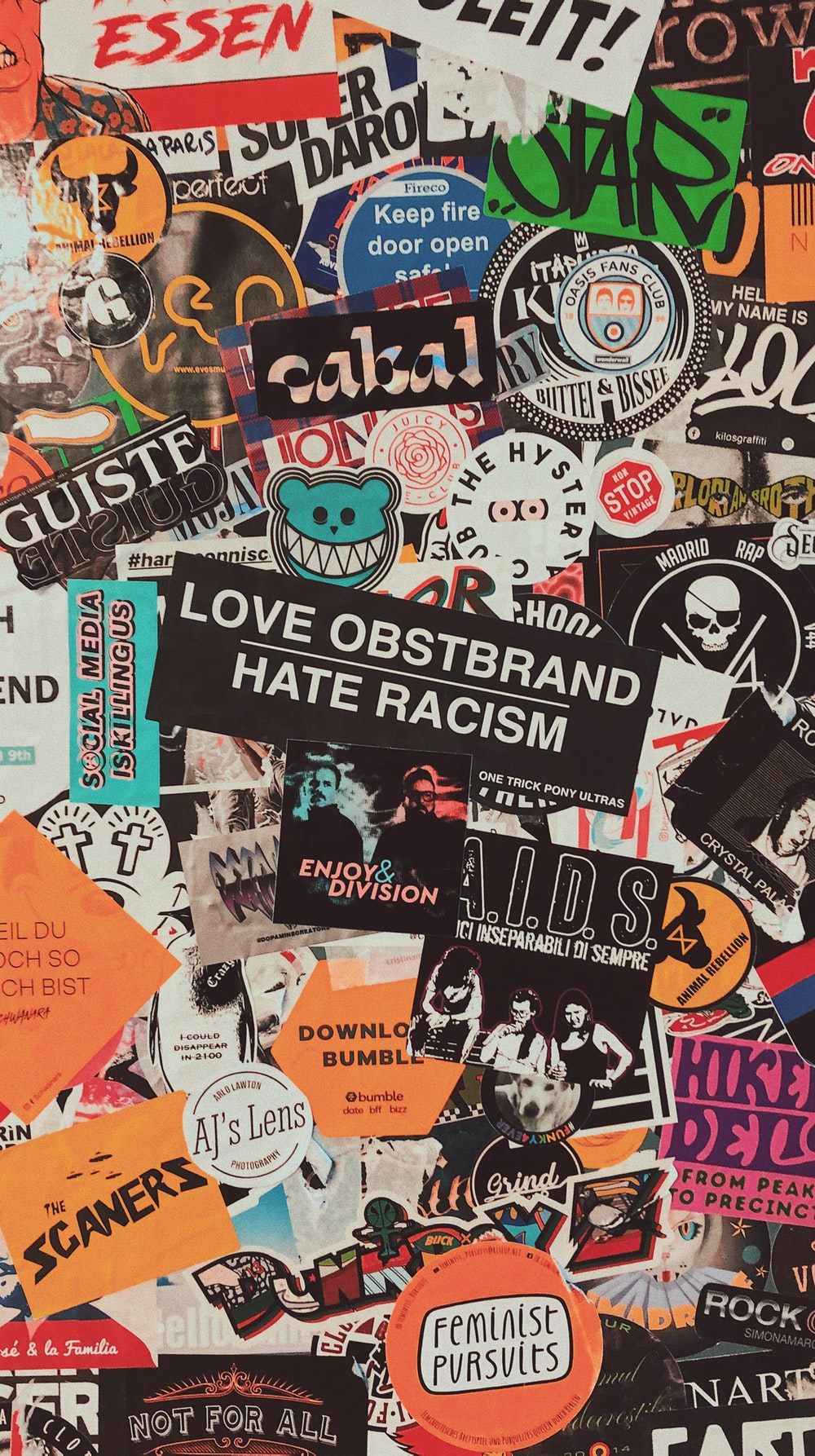 assorted stickers on white wall