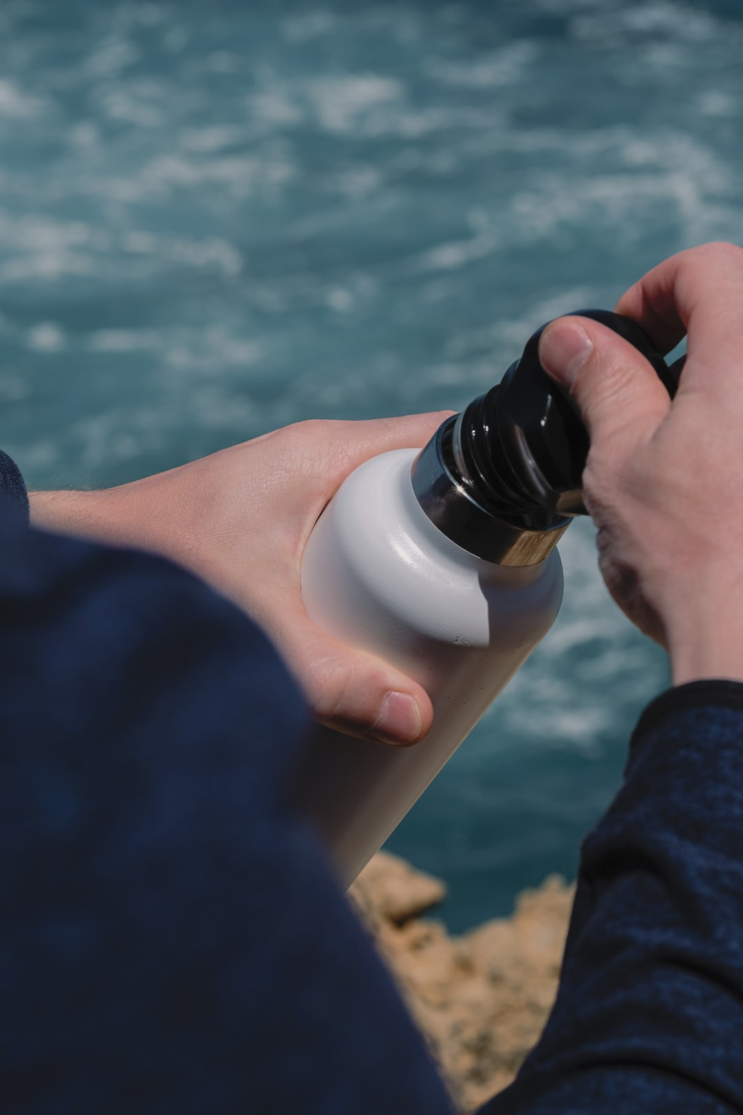 man holding reusable thermo bottle in hands