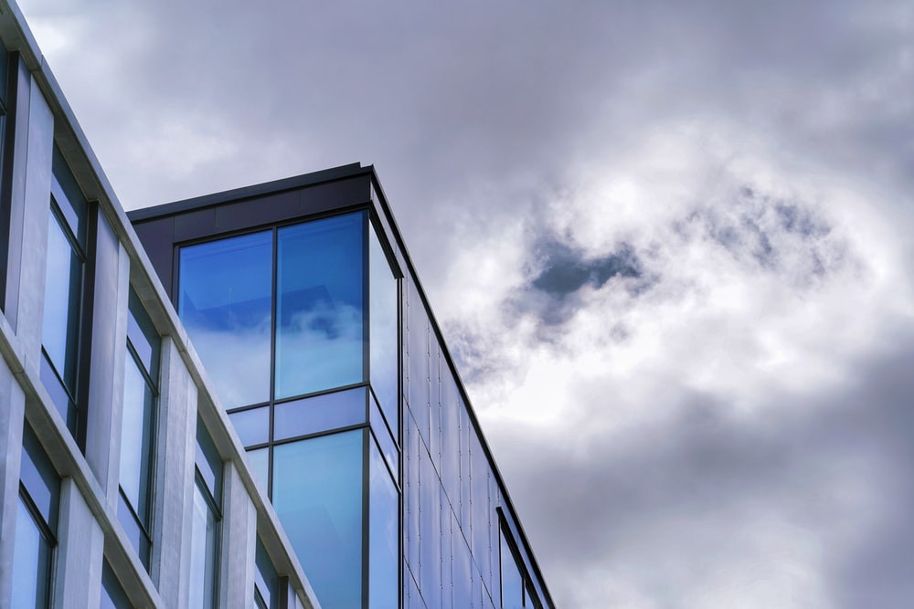 grayscale photo of glass window building