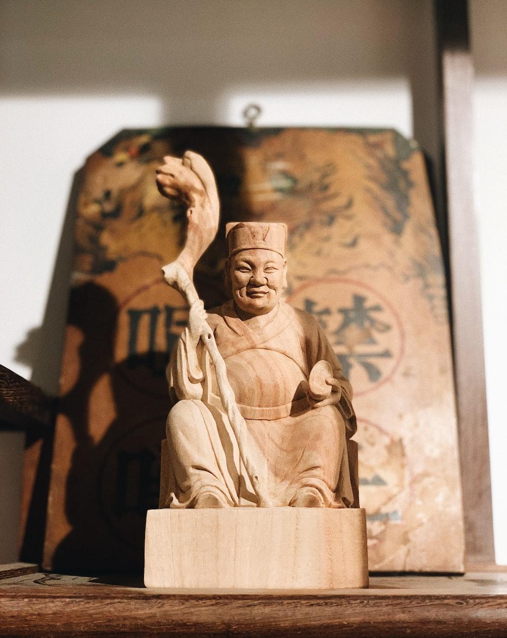 man in robe statue photo