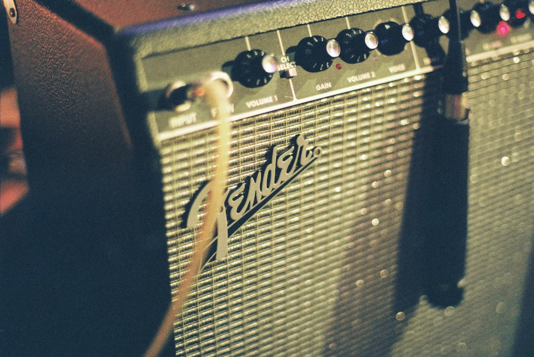 closeup of a fender guitar amplifier with a shure microphone